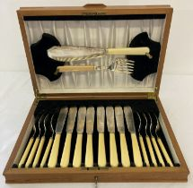 A wooden cased, 8 serving, vintage set of fish knives, forks & servers by John Sanderson, Sheffield.