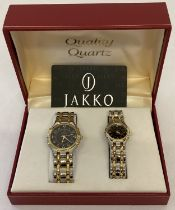 A boxed ladies and gents matching quartz wristwatch set.