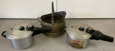 A vintage brass coal bucket together with 2 vintage Prestige pressure cookers.