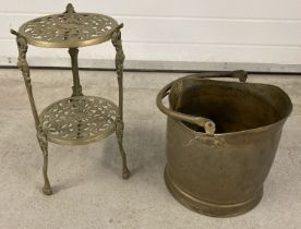 A two tier pierced work plant/saucepan stand with floral and cherub decoration.