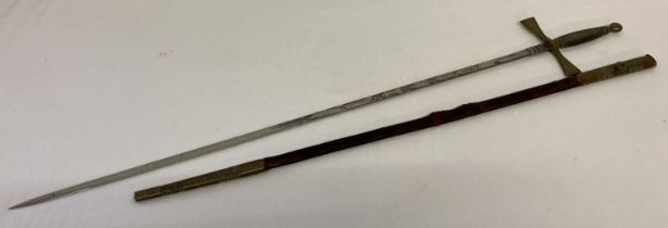 A 20th century Masonic ceremonial sword with brass pommel, grip and cross guard.