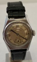 A vintage waterproof watch by Dimra with secondary dial.