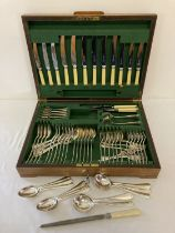 A vintage wooden cased canteen of cutlery by Atkin Brothers, Sheffield. Total of 75 pieces.