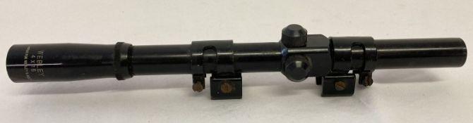 A Webley & Scott Ltd 4 x 15 rifle sight scope.