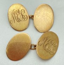 A pair of vintage 9ct gold oval shaped cufflinks engraved with 'M.E.L' monogram. Total weight