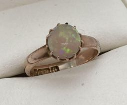 A child's vintage Opal set 9ct gold ring. Fully hallmarked inside band, with Birmingham assay