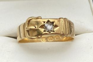 A vintage 18ct gold buckle design ring set with a single round cut 0.07ct diamond. Fully