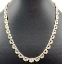 A contemporary design decorative West German silver necklace with spring clasp and extension