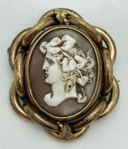 A large Victorian mourning brooch with rotating central panel and pinchbeck mount. Swivel panel