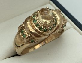 A 9ct gold dress ring set with citrine and tsavorite, by Gems TV. Central raised citrine cabochon