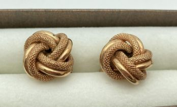 A pair of 9ct gold large knot style stud earrings complete with butterfly backs. Full hallmarks to
