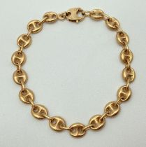 A 9ct hollow gold puffed anchor/mariners link bracelet with lobster style clasp. Full hallmarks to