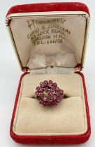 A 14ct Chinese gold and ruby vintage domed style cluster ring. 25 small round cut rubies set in a