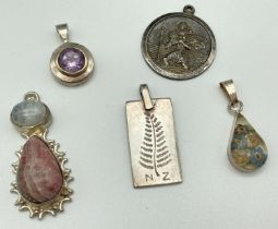 5 silver and white metal vintage and modern pendants. A circular St. Christopher, a silver panel