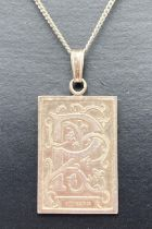 """A vintage square silver pendant with letter P and floral decoration on an 18"""" fine curb chain."""