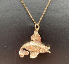 """A 9ct gold fish pendant on a 9ct gold 19"""" fine curb chain with spring clasp. Bottom fin to fish"""