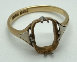A vintage 18ct gold dress ring (stone missing) with platinum detail to shoulders and claws.