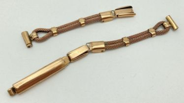 A vintage 9ct gold ladies wristwatch strap in a banded mesh design. Marked 9ct throughout. Total