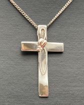 """A silver and Welsh gold accent Clogau cross pendant on an 18 inch curb chain. Pendant marked """""""
