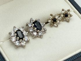 2 pairs of vintage 9ct gold sapphire and white stone stud earrings. A small pair set with central
