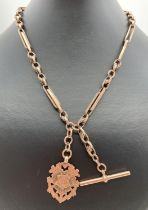 A late 19th century 9ct gold albert watch chain with decorative monogrammed fob. T bar, lobster