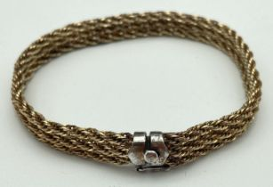 A vintage triple rope chain design silver gilt bracelet with push clasp and safety clip. Approx 8