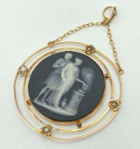 An antique Wedgwood black jasperware & 14ct gold cameo style pendant with seed pearl detail.