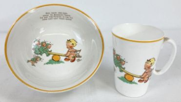 2 pieces of Shelley Mable Lucie Attwell nursey ceramics with fairies See-saw design. A tall slim mug