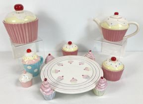 A quantity of assorted modern novelty cupcake design kitchen ceramics. To include: cake stand,