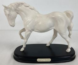 """A Royal Doulton """"Spirit of Freedom"""" ceramic horse figurine mounted on a wooden plinth. In white matt"""