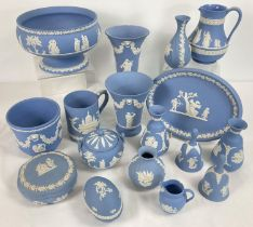 A collection of 17 items of Wedgwood blue and white jasperware ceramics. To include: pairs of vases,
