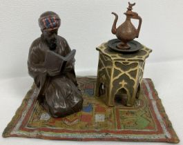 After Bergman - a cold painted Arabian style inkwell. An Arabian gentleman knelt reading on a