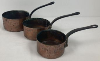 A set of 3 vintage graduating French copper saucepans with riveted handles. Largest approx. 16cm