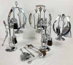 A collection of 6 mid century chrome fireside companion sets. To include novelty horseshoe shaped