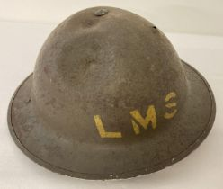 British MkII steel helmet painted khaki with stencilled 'LMS' (London Midland Scottish Railway).