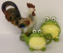 A large painted ceramic cockerel figurine together with a modern ceramic biscuit barrel and teapot
