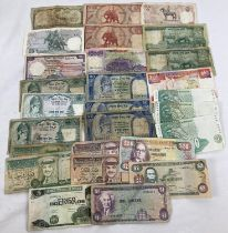 A collection of 29 assorted foreign bank notes. To include notes from: Nepal, Thailand, Singapore,