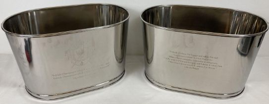 A pair of large Bollinger Champagne buckets with engraved details to sides. One side is engraved