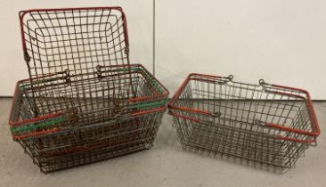 6 vintage wire shopping baskets with red and green plastic grip handles.