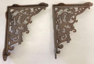 A pair of rust effect cast metal wall shelf bracelets, with decorative scroll & leaf design. Approx.