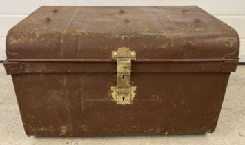A Victorian tin trunk with original brass catch and lock and studded detail to lid. Approx. 37 x