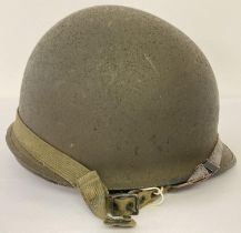 Original US M1C WW2 Paratrooper helmet - 1944 specification, rear join. Complete with helmet