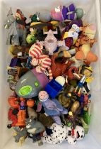 A large quantity of unsealed play worn McDonalds Happy Meal toys.