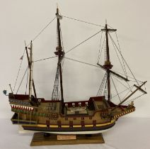 A handmade wooden scale model of a 16th century galleon with 20 guns.