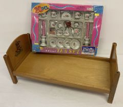 A vintage dolls bed with transfer detail to headboard.