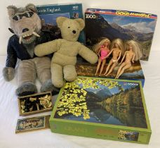 A collection of assorted vintage toys to include Barbie dolls, wooden chess pieces & jigsaw puzzles.