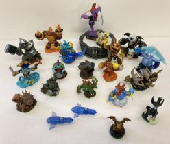 A collection of Skylander interactive figures together with a portal stand and a Strategy guide.