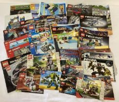 A quantity of assorted Lego instruction manual, leaflets and posters.