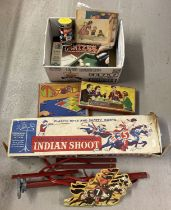 A Mettoy Playthings Indian Shoot game (gun missing) together with a box of vintage games.