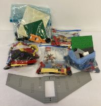 A collection of assorted Lego pieces and play sets.